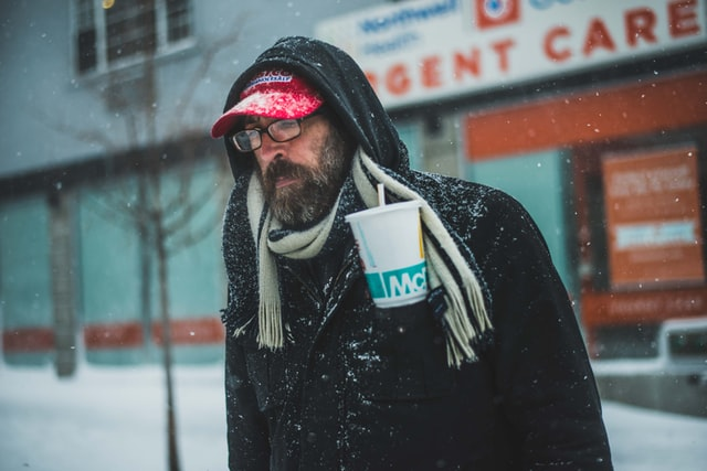 benefits of beards: Bearded man in scarf in the snow.